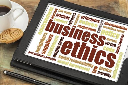 intellectual property law: business ethics word cloud on a digital tablet with cup of coffee Stock Photo