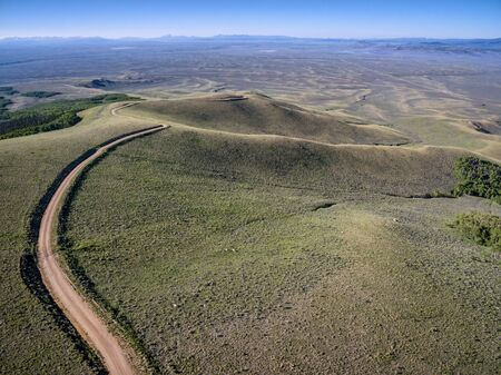 back country: windy back country road aerial view - Independence Mountain Road in North Park, Colorado - aerial view towards Walden and North Platte RIver valley Stock Photo