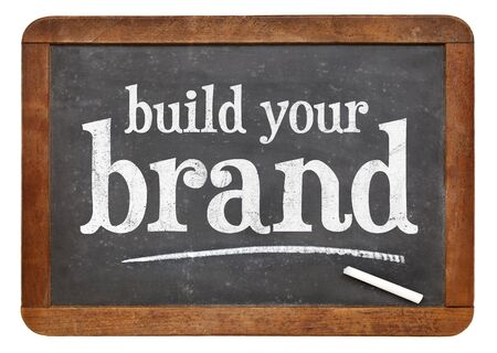build your brand  - white chalk text on a vintage slate blackboard 스톡 콘텐츠