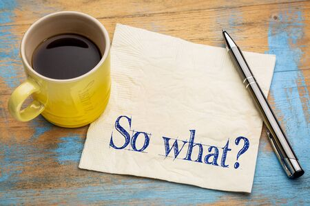 irrelevant: So what question - indifference concept - handwriting on a napkin with a cup of espresso coffee