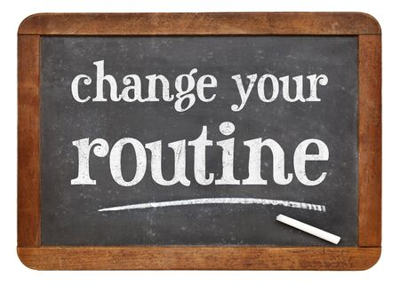 change your routine  - white chalk text on a vintage slate blackboard Stock Photo