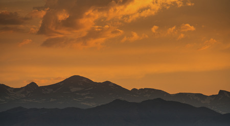 front range: silhouette of Front Range of Rocky Mountains against sunset sky, Longmont, Colorado Stock Photo