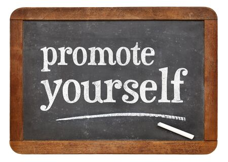 promote: promote yourself  - white chalk text on a vintage slate blackboard