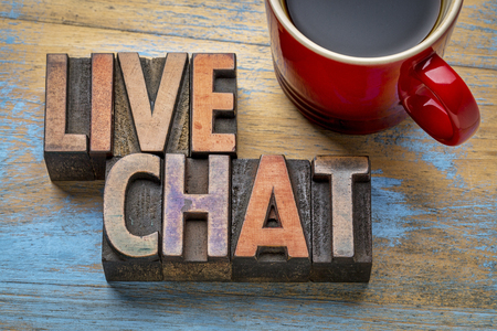 letterpress type: live chat word abstract in vintage letterpress wood type with a cup of coffee