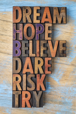 dream, hope, believe, dare, risk and try - inspirational word abstract - text in vintage letterpress wood type printing blocks