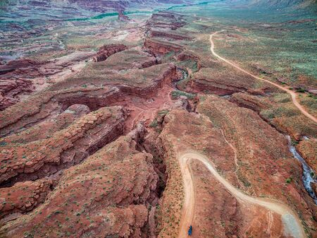 aerial view of a creek and road in canyon country near Moab, Utah