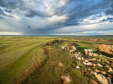 natural landmark: Storm clouds over prairie at Sand Creek National Natural Landmark, Albany County, Wyoming -aerial view Stock Photo