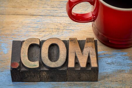dot com business internet domain - text in vintage letterpress wood type blocks with a cup of coffee Imagens - 69205675