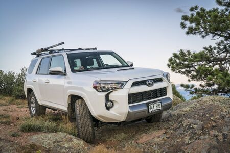 CHEROKEE PARK, CO, USA - JUNE 12, 2016: Toyota 4Runner SUV (2016 Trail edition) on a rocky  trail in Colorados Rocky Mountains