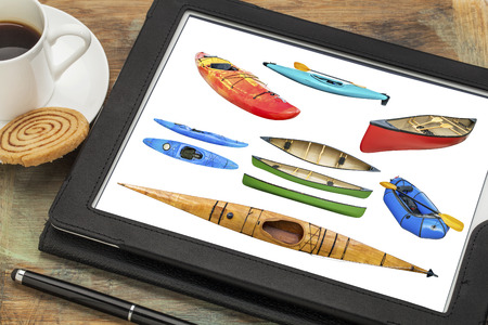 Reviewing isolated pictures of paddling boats (kayak, canoe, raft) on a tablet with cup of coffee. All screen images copyright by the photographer and included at high resolution in the portfolio.