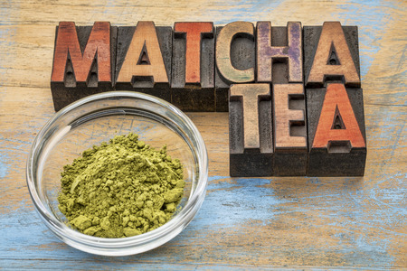 letterpress type: glass bowl  of organic matcha green tea powder with text in vintage letterpress wood type