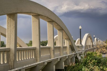 south platte river: Rainbow arch bridge over South Platte River in Fort Morgan, Colorado Stock Photo