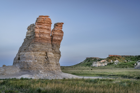 castle rock: Castle Rock - limestone pillar landmark in prairie of western Kansas near Quinter (Gove County) , summer dusk scenery Stock Photo