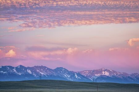 Medicine Bow Mountains at dusk in early summer, North Park, Colorado near Cowdrey