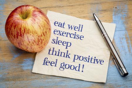 sleep well: think positive , exercise, eat well, sleep - concept of feeling good - handwriting on a napkin with an apple