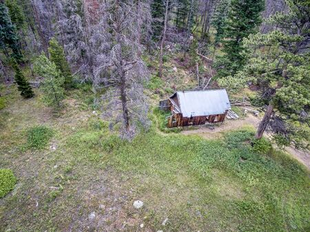 aerial view of ruins of a rustic cabin along Old Flowers Road in Roosevelt National Forest, a popular jeep trail near Fort Collins, Colorado