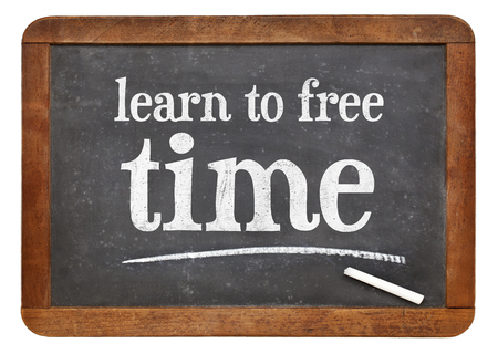 free time: learn to free time - white chalk text on a vintage slate blackboard