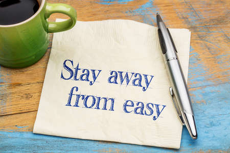 Stay away from easy inspirational advice - handwriting on a napkin with a cup of coffee