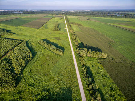 aerial view of a gravel road and fields near Mississippi and Missouri Rivers confluence at Columbia Bottom Conservation Area