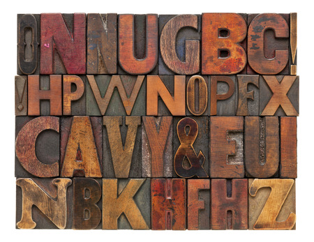 random alphabet letters - vintage letterpress wood type, different size and style of fonts with ink patina