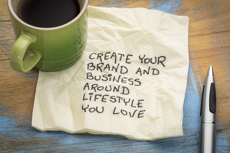 create your brand and business around lifestyle you love - handwriting on a napkin with a cup of coffee