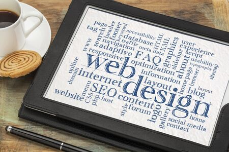web or website design concept - a word cloud on a digital tablet with a cup of coffee Stock Photo