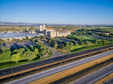 FORT COLLINS, CO, USA - AUGUST 14, 2016: Interstate freeway i-25 and Anheuser-Bush Brewery - aerial view.