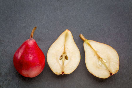 red pears on a gray slate stone background