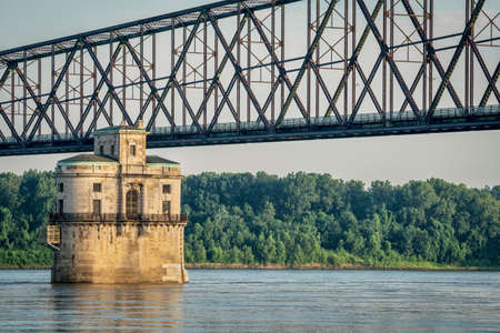 mississippi river: Historic water intake tower number 2 built in 1915 and the Old Chain of Rocks bridge on the Mississippi River above St Louis