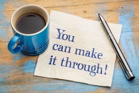 tu puedes: You can make it through! Handwriting on a napkin with a cup of espresso coffee. Foto de archivo