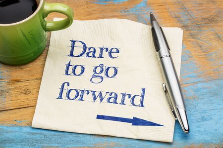 dare: Dare to go forward - handwriting on a napkin with a cup of espresso coffee