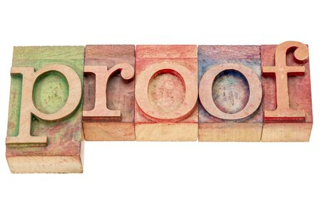 corroboration: proof - isolated word abstract in letterpress wood type printing blocks stained by color inks