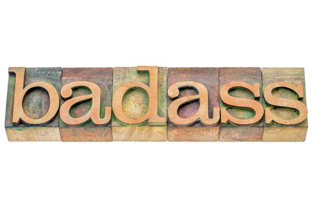 troublemaker: badass  - isolated word abstract in letterpress wood type printing blocks stained by color inks Stock Photo