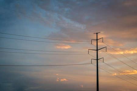 powerline: power line silhouette against sunset sky Stock Photo