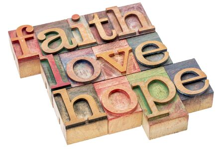 metaphysical: biblical, spiritual  or metaphysical reminder - faith, hope and love - word abstract in letterpress wood type blocks, stained by colorful inks, isolated on white