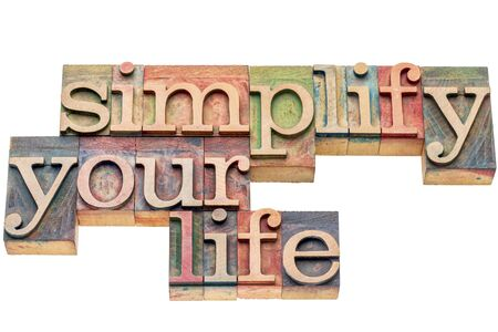 printing block block: simplify your life advice -  isolated word abstract in letterpress wood type