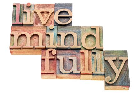 wood type: live mindfully - isolated word abstract in letterpress wood type