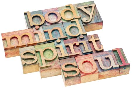 body, mind, spirit and soul word abstract - isolated text in letterpress wood type printing blocks Stock Photo