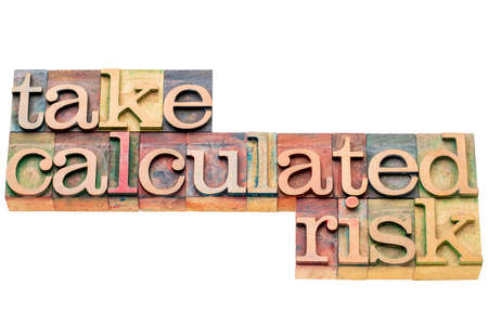 calculated: take calculated risk - isolated word abstract in letterpress wood type