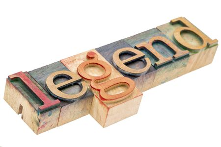 legend word - isolated text in letterpress wood type stained by color inks Stock Photo