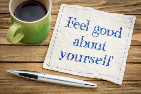 self image: feel good about yourself advice or reminder - handwriting on a napkin with a cup of espresso coffee Stock Photo
