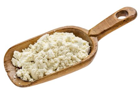 whey: whey protein powder on  a rustic wooden scoop isolated on white