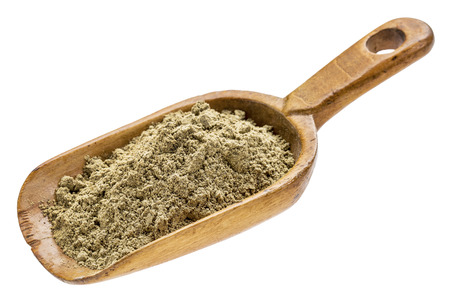 hemp seed protein powder on a rustic wooden scoop isolated on white