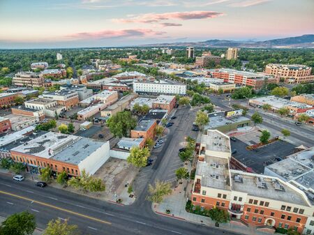 fort collins: FORT COLLINS, CO, USA - SEPTEMBER 11, 2016: Downtown of Fort Collins, Colorado at late summer dawn  - aerial view with wide angle distortion and Rocky Mountains in background..