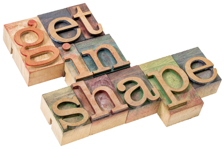 get in shape  motivational word abstract- isolated text in letterpress wood type printing blocks stained by color inks