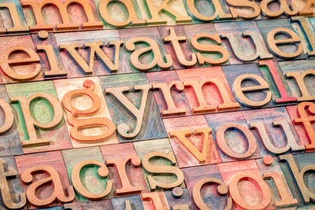 alphabet abstract background - random letters in letterpress wood type printing blocks Stock Photo