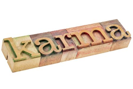 karma: karma word - isolated text in letterpress wood type printing blocks stained by color inks