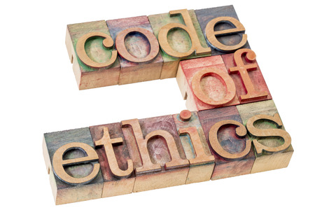 code of ethics word abstract - isolated text in letterpress wood type printing blocks stained by color inks Standard-Bild