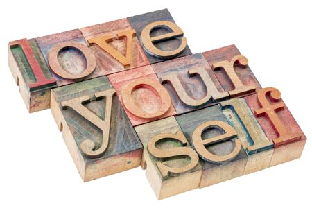 love yourself - self esteem concept - isolated text in vintage letterpress wood type printing blocks