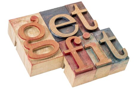 printing block block: get fit motivational concept - isolated word abstract in letterpress wood type blocks